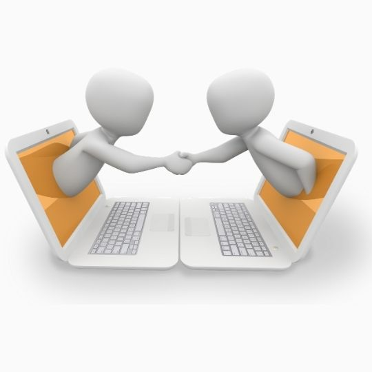 Cartoon of two figures emerging from two laptops and shaking hands.